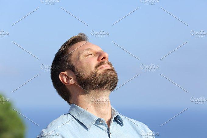 Man breathing deep fresh air outdoors.jpg - Health