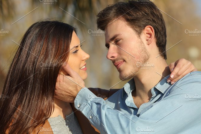Couple in love ready to kiss in a park.jpg - People