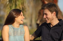 Friends laughing and taking a conversation in a park.jpg