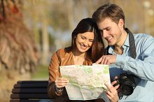 Tourists searching in a map outdoors.jpg