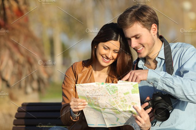 Tourists searching in a map outdoors.jpg - Holidays