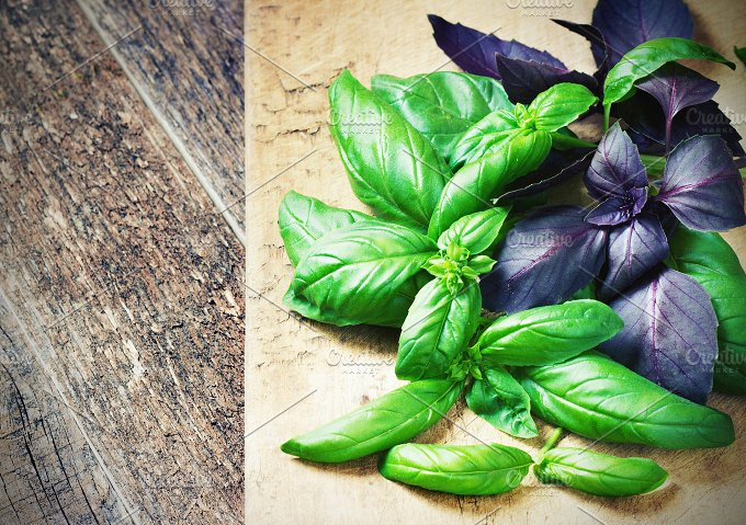 Bunch fresh basil on a wooden background. Aromatic spice. - Food & Drink