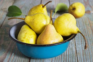 yellow pear in a metal bowl