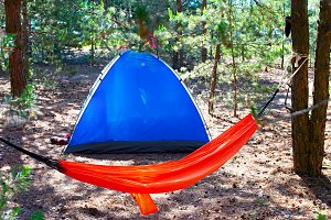 Camping tent and orange hammock