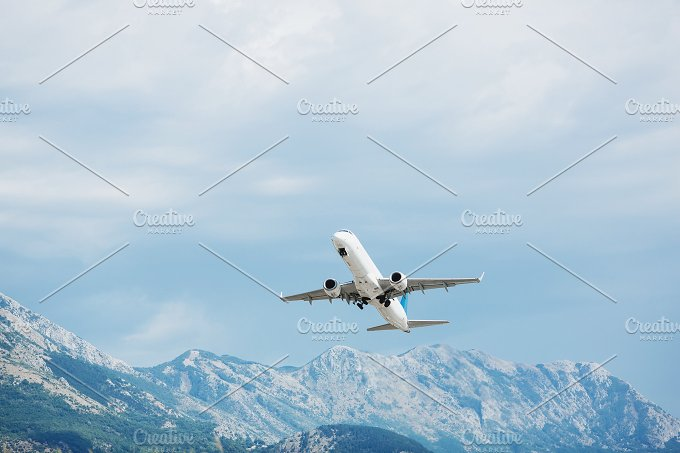 Airplane take off. Mountains view. - Transportation