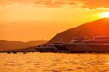 Yachts parking in sunset marina.