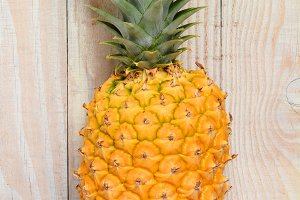 Pineapple Against Wood Background