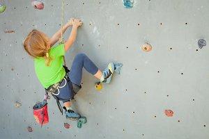 Little girl climbing rockwall