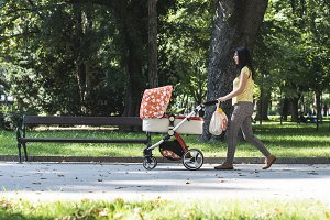 Mother walking in the park with baby