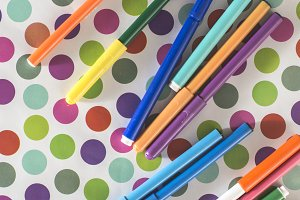 Pens on colorful circles
