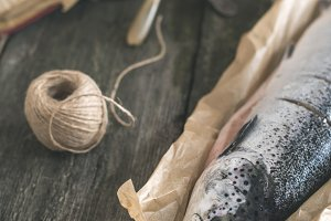 Raw salmon fish on vintage wooden t