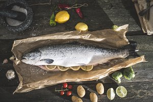 Preparing whole salmon fish for cook