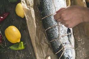 ying a rope on fish for grilling.