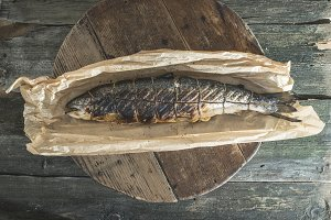 Roasted salmon fish on baking paper.