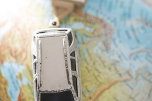 Car and caravan on globe