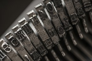 Metal letters on typewriter