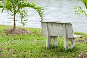 Stone bench in the grass