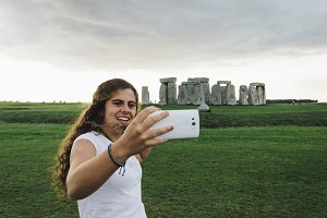Girl taking a selfie at Stonehenge