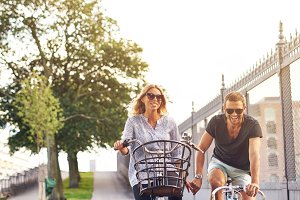 Romantic couple cycling holding hand