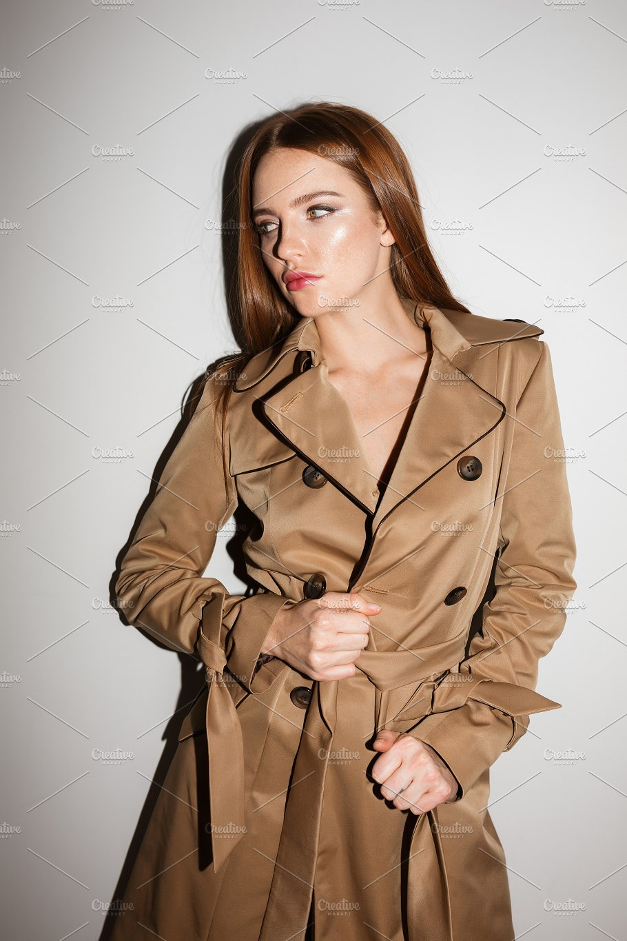 hot sale online 89fac c295a Young lady in trench coat standing