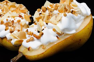 Pear with whipped cream and nuts
