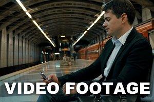 Businessman Waiting fot Tube Train