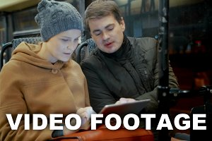 Friends with Tablet Riding a Bus