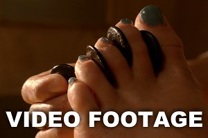 Spa feet treatment with hot stones