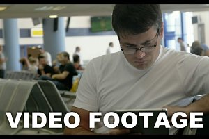 Young man working with touch pad