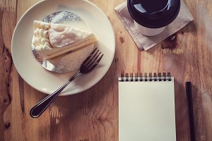 Coffee ,cake,notebook paper and pen