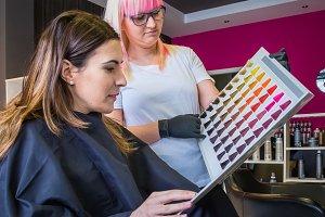 Woman looking a hair dye palette