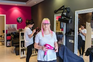 Woman hairdresser in hair salon