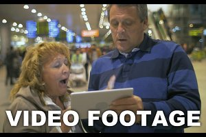 Senior couple with touch pad