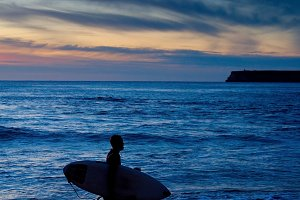 Surfer in the dusk, Algarve,Portugal