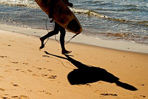 Surfer with surfboard, Portugal