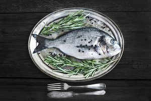 Fresh sea fish on a metal dish