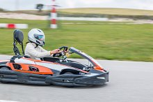 Woman driving fast in a karting circ