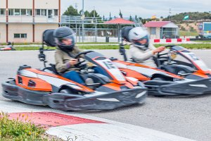 Woman taking over in a karting race