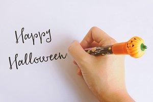 Happy halloween word written by pen