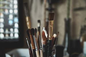stylized photo of paint brushes