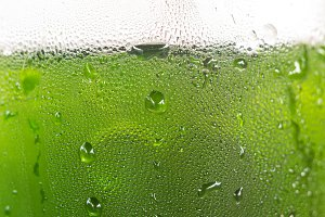 Water drop on bottle of green drink