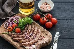 Grilled sausages & mug of light beer