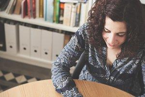 Brunette girl working in modern desk