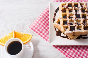 Waffles,coffee and oranges