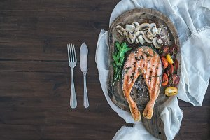 Grilled salmon steak with mushrooms