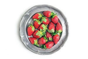 Vintage plate full of strawberries