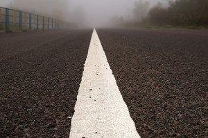 Road in autumn fog