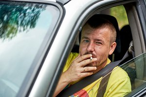 Man smoking in a car