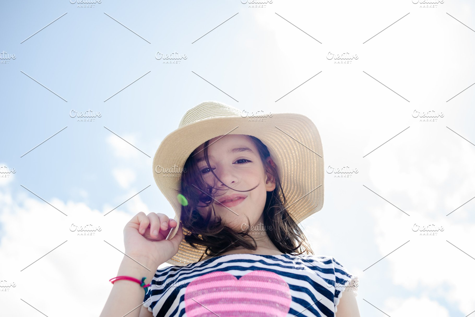 affc177e9 Young girl in sun hat with blue sky