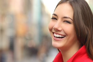 Woman white smile with a perfect teeth in the street.jpg